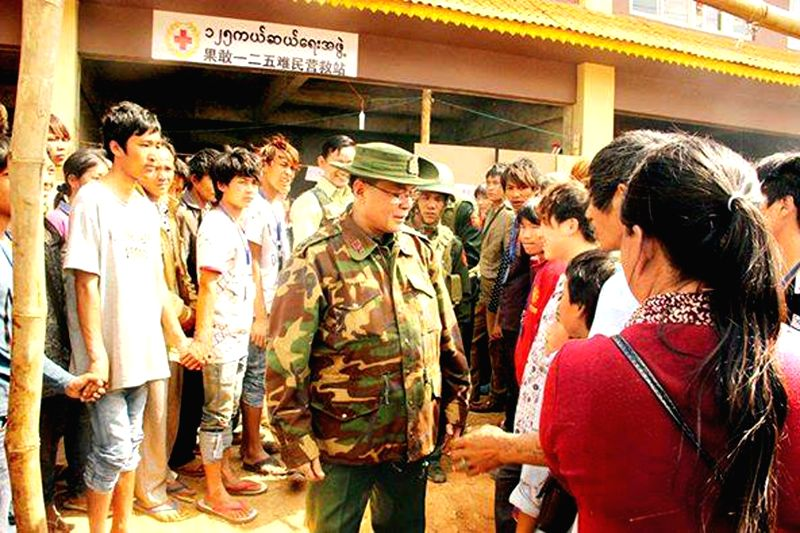 Col. Saw Myint Oo (C), the Laukkai Regional Commander, welcomes the back residents in Laukkai, the capital of Kokang region in northeastern Shan state, Myanmar, ...