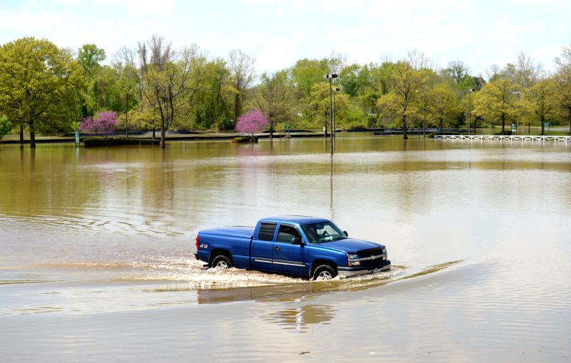 LAUREL (U.S.), May 1, 2014 A pickup truck runs on a flooded street in Laurel, Marryland, the United States, May 1, 2014. High water and flooding following torrential rains yesterday has ..