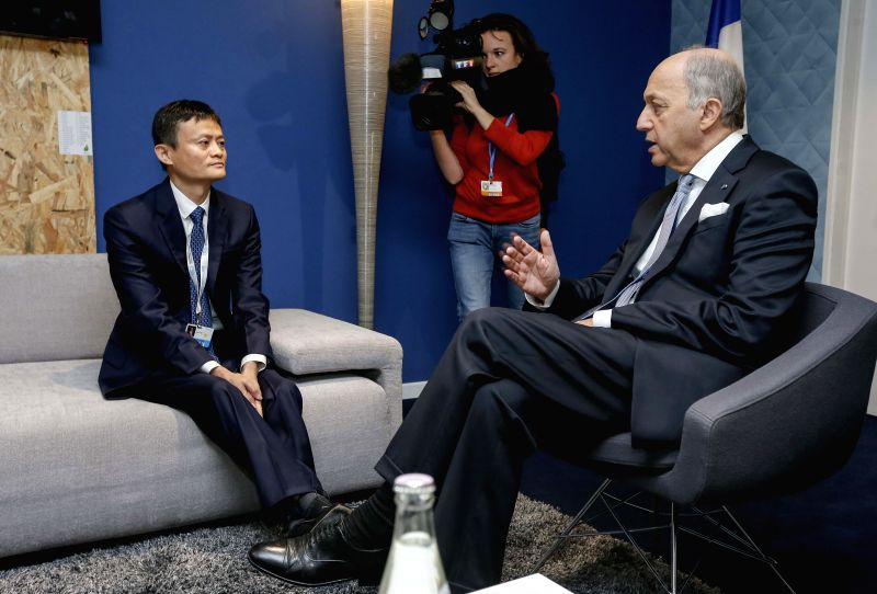 Laurent Fabius (R), French foreign minister and chair of the 21st UN Climate Change Conference, meets with Alibaba's founder and chairman Jack Ma in Paris Dec. 5, ...