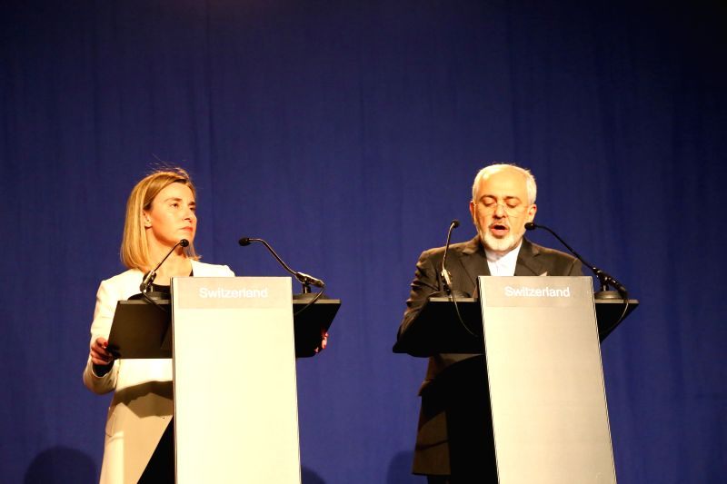 EU Foreign Policy Chief Federica Mogherini(L) and Iran's Foreign Minister Javad Zarif read a joint statement in Lausanne, Switzerland, on April 2, 2015. Top ... - Javad Zarif