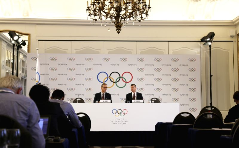 LAUSANNE, July 19, 2018 - International Olympic Committee (IOC) Director of Communications Mark Adams (L) and IOC Sports Director Kit McConnell host a press conference in Lausanne, Switzerland, July ...