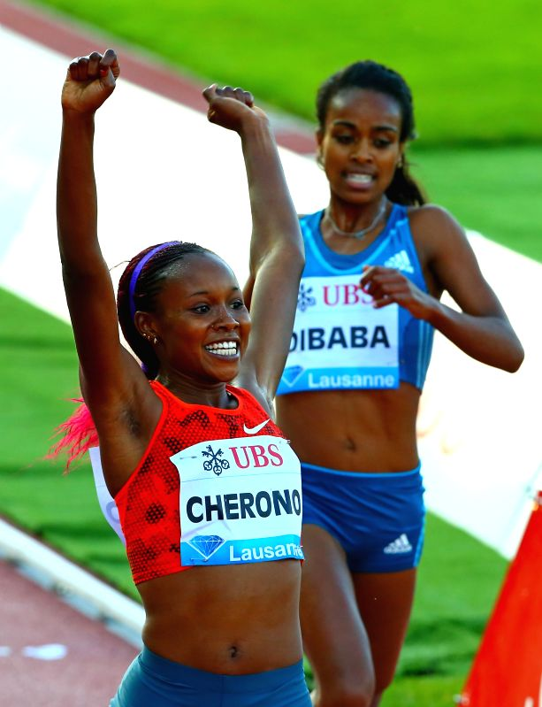 Kenya's Mercy Chernon celebrates after the women's 3000m race during the IAAF Diamond League Meetings in Lausanne, Switzerland, July 3, 2014. Mercy Chernon claimed .