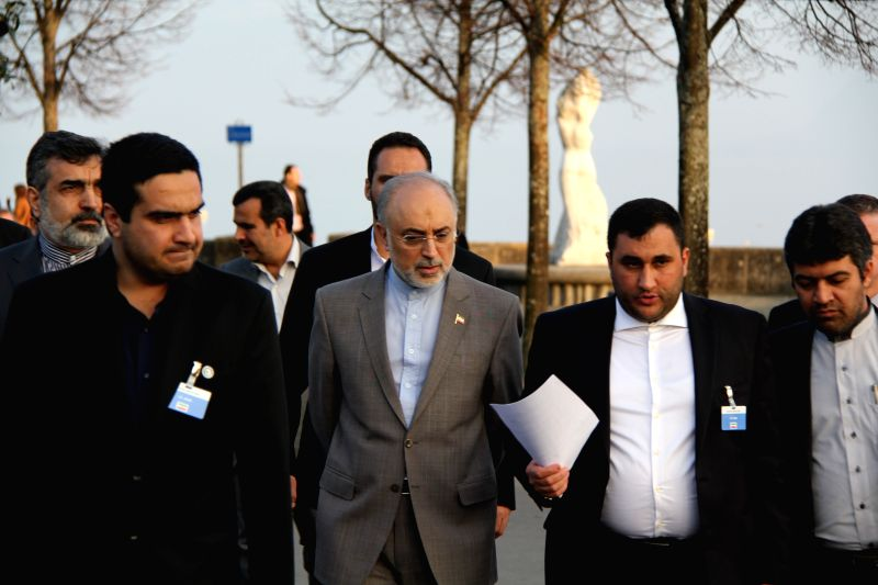 Members of Iran's delegation talks with Iran's atomic agency chief Ali Akbar Salehi in Lausanne, Switzerland, on March 18, 2015. Senior officials from Iran and ...