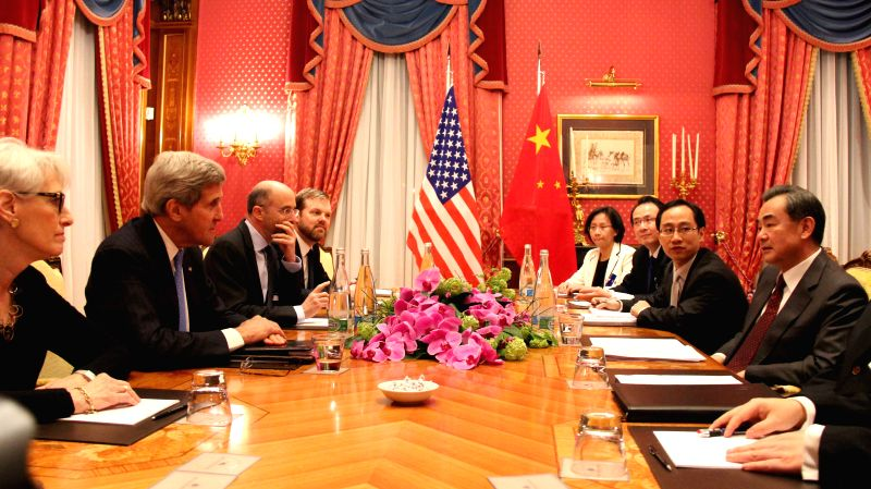 Chinese Foreign Minister Wang Yi (1st R) meets with U.S. Secretary of State John Kerry (2nd L) in Lausanne, Switzerland, on March 29, 2015. (Xinhua/Zhang ... - Wang Y