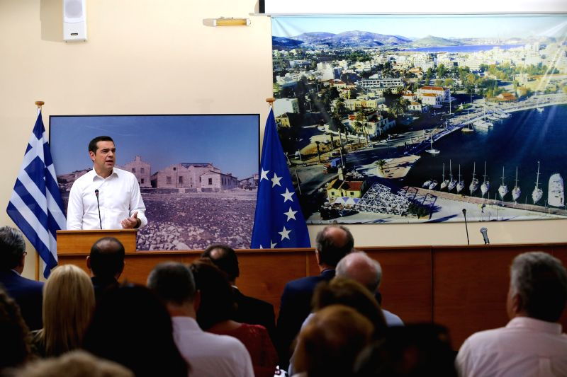 LAVRIO, Aug. 7, 2018 - Greek Prime Minister Alexis Tsirpas delivers a speech in Lavrio, Greece, Aug. 7, 2018. At least 3,200 illegal constructions will be demolished in Attica region and more across ... - Alexis Tsirpas