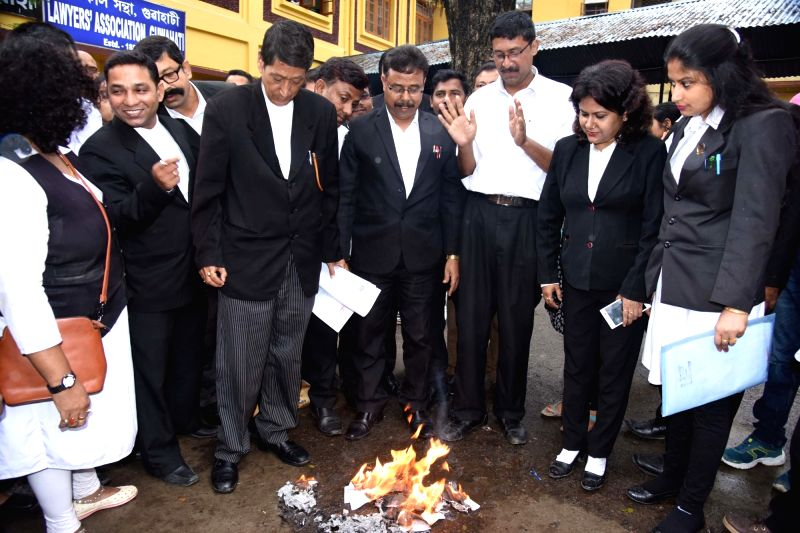 Lawyers burn copies of Advocates Act (Amendment) Bill 2017 to protest against Law Commission recommendations, including a proposal to ban strikes by advocates in Guwahati on April 21, 2017.