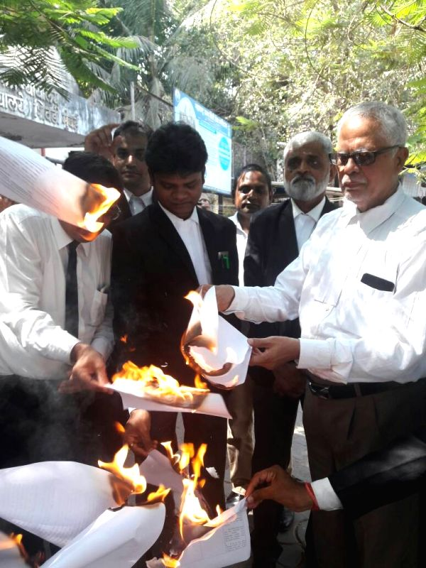 Lawyers burn copies of Advocates Act (Amendment) Bill 2017 to protest against Law Commission recommendations, including a proposal to ban strikes by advocates in Mumbai on April 21, 2017.