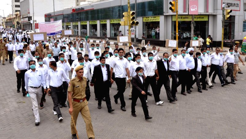 Lawyers participate in a silent rally in Jaipur on July 21, 2014.