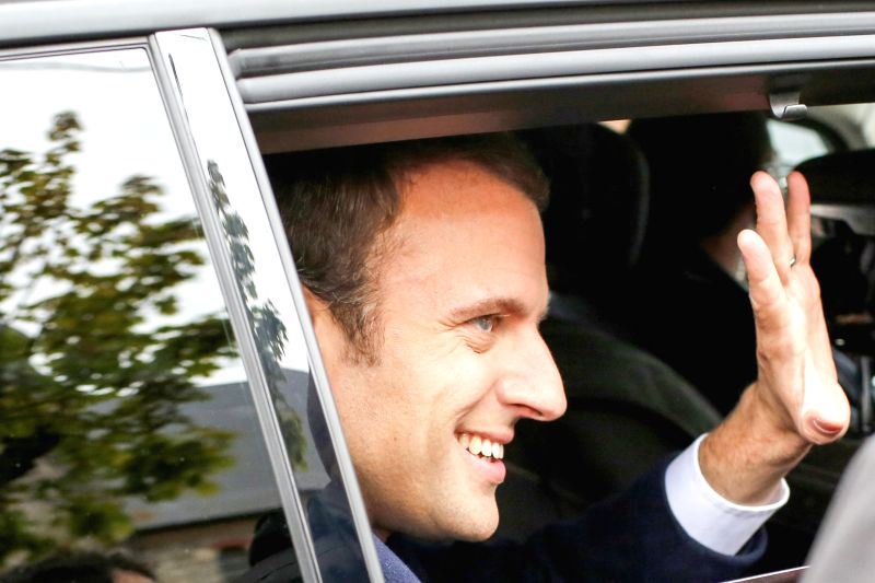 LE TOUQUET, April 23, 2017 - Emmanuel Macron, presidential candidate for the On the Move (En Marche) movement, leaves after he casted his ballots during the French presidential election in Le ...