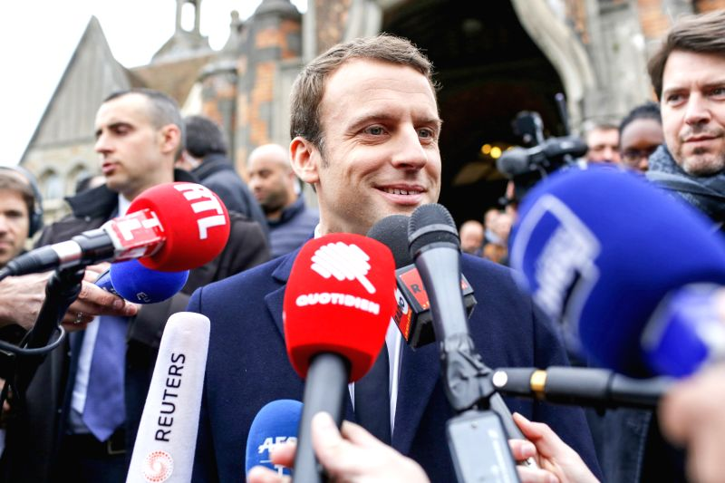 LE TOUQUET, April 23, 2017 - Emmanuel Macron (C), presidential candidate for the On the Move (En Marche) movement, talks to the media after he casted his ballots during the French presidential ...