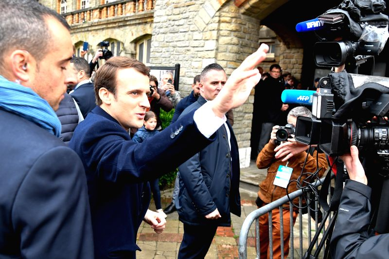 LE TOUQUET, May 7, 2017 - Emmanuel Macron (2nd L), presidential candidate for the En Marche! (On the Move!) movement, greets his supporters as he arrives to cast his ballot in the second round of the ...