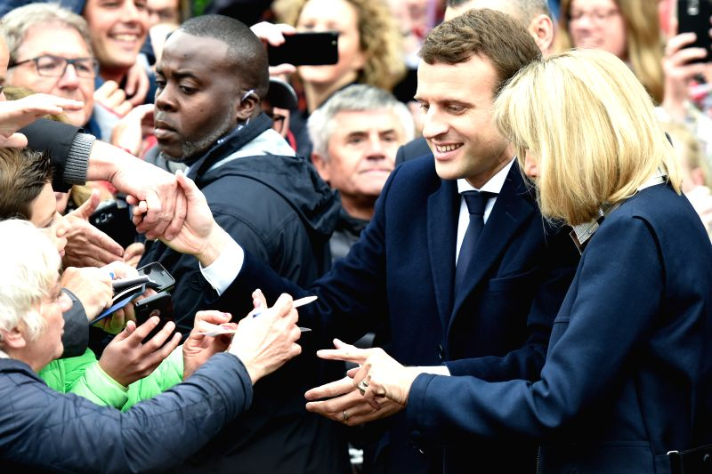 LE TOUQUET, May 7, 2017 - Emmanuel Macron (2nd R), presidential candidate for the En Marche! (On the Move!) movement, greets his supporters after he casted his ballot in the second round of the ...
