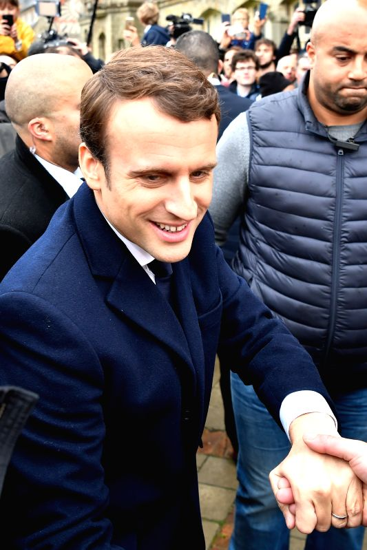 LE TOUQUET, May 7, 2017 - Emmanuel Macron (front), presidential candidate for the En Marche! (On the Move!) movement, greets his supporters as he arrives to cast his ballot in the second round of the ...