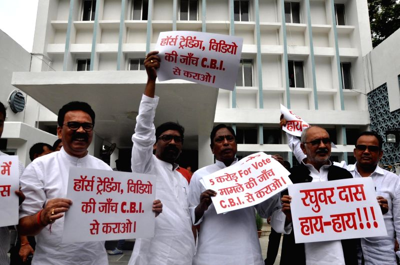 Leader of Opposition Hemant Soren stage a demonstration against Jharkhand Government in connection with horse trading on Rajya Shabha Election outside Jharkhand Assembly premises in Ranchi on ...