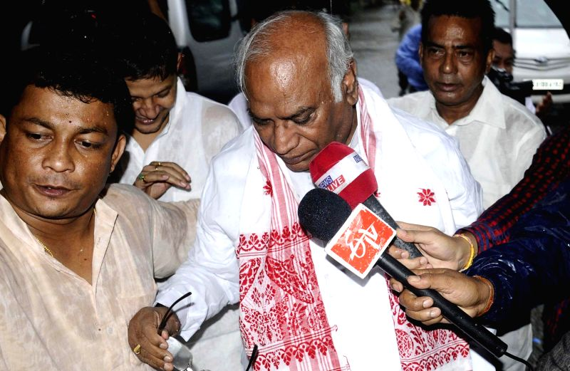 Leader of the Congress parliamentary party in Lok Sabha Mallikarjun Kharge arrives at Rajiv Bhawan in Guwahati on June 23, 2014.