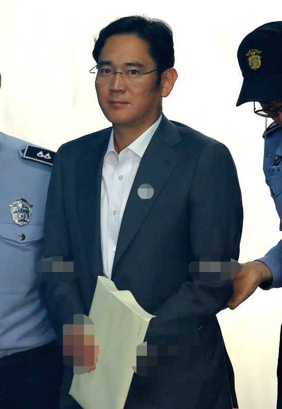 Lee Jae-yong, vice chairman of Samsung Electronics Co., enters the Seoul Central District Court in Seoul on May 2, 2017, to attend a trial for alleged bribery related to the merger of two of ...