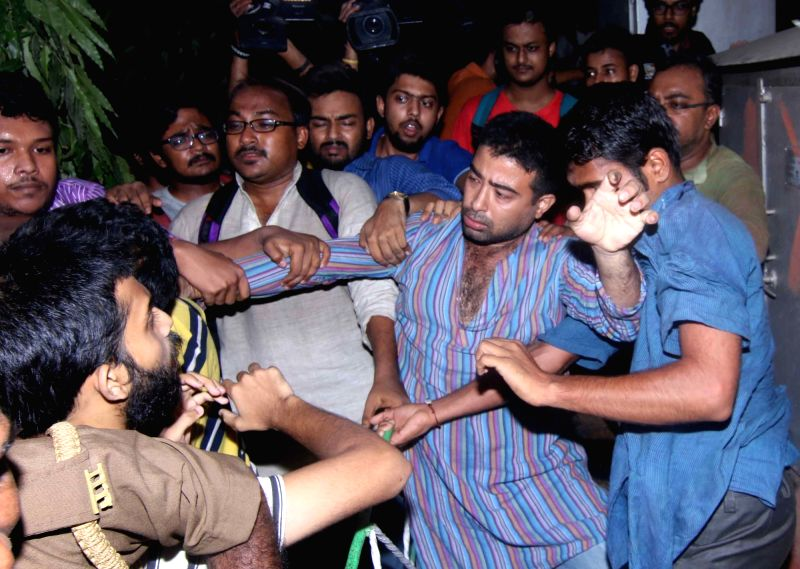 "Left and ABVP students clash with each other during screening of the film ""Buddha In A Traffic Jam"" at Jadavpur University campus in Kolkata on May 6, 2016."