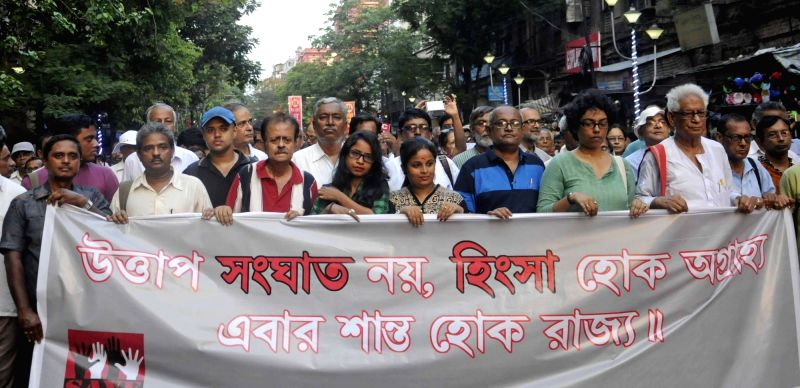 Left and Congress workers participate in a demonstration against post poll violence in West Bengal; in Kolkata, on May 13, 2016.