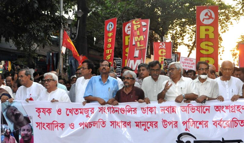 Left Front Chairman Biman Bose, CPI-M leader Surjya Kanta Mishra and others participate in a rally organised to condemn 22nd May police action on protesters in Kolkata, on May 23, 2017. - Biman Bose and Surjya Kanta Mishra
