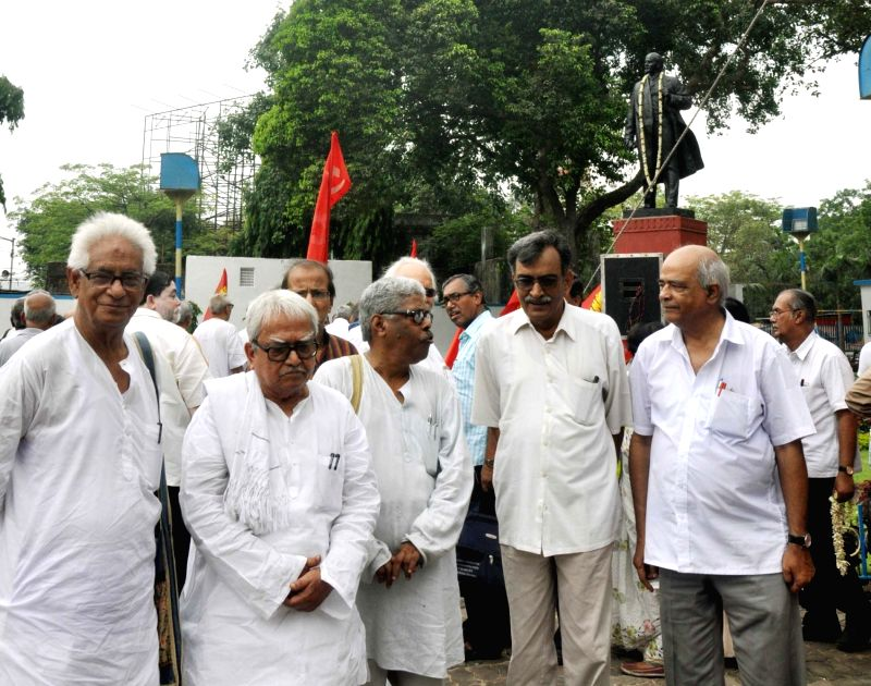 Left Front Chairman Biman Bose, CPI(M) West Bengal state secretory Surja Kanta Mishra with other leaders pay tribute to Vladimir Lenin on his birth anniversary in Kolkata on April 22, 2017. - Biman Bose and Surja Kanta Mishra