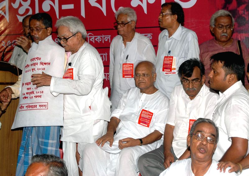 Left Front chairman Biman Bose, Leader of Opposition in West Bengal Legislative Assembly and others during a three day long dharna called to protest against various issues in Kolkata on June 25, ... - Biman Bose