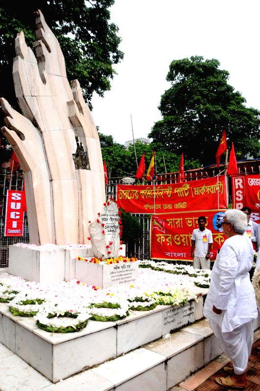 Left Front chairman Biman Bose pays tribute to the martyrs on `Shahid Divas` in Kolkata on Aug 31, 2014. - Biman Bose