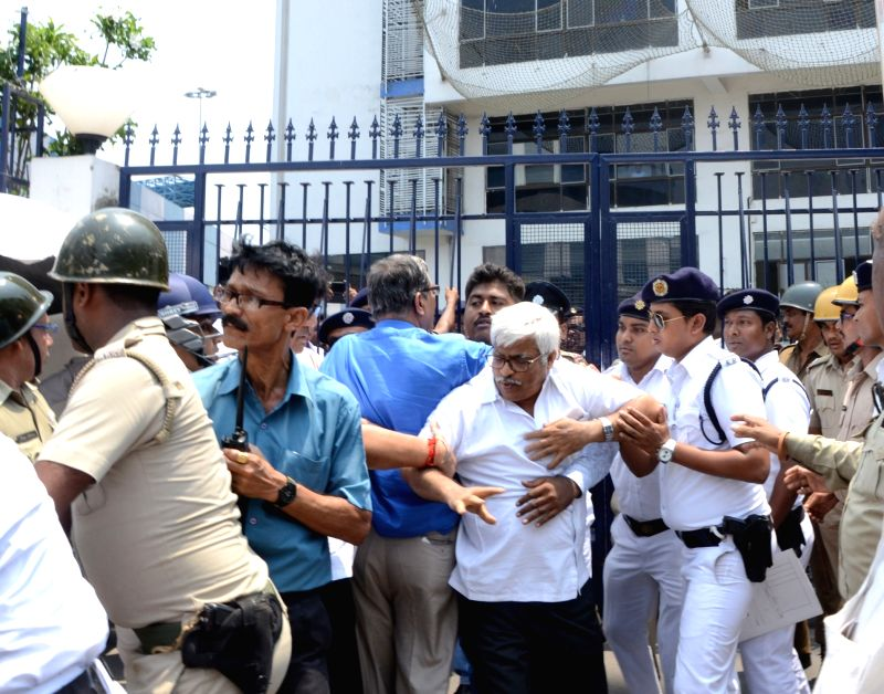 Left Front leader Sujan Chakraborty being detained by police outside the West Bengal Secretariat in Howrah, on May 22, 2017. - Sujan Chakraborty