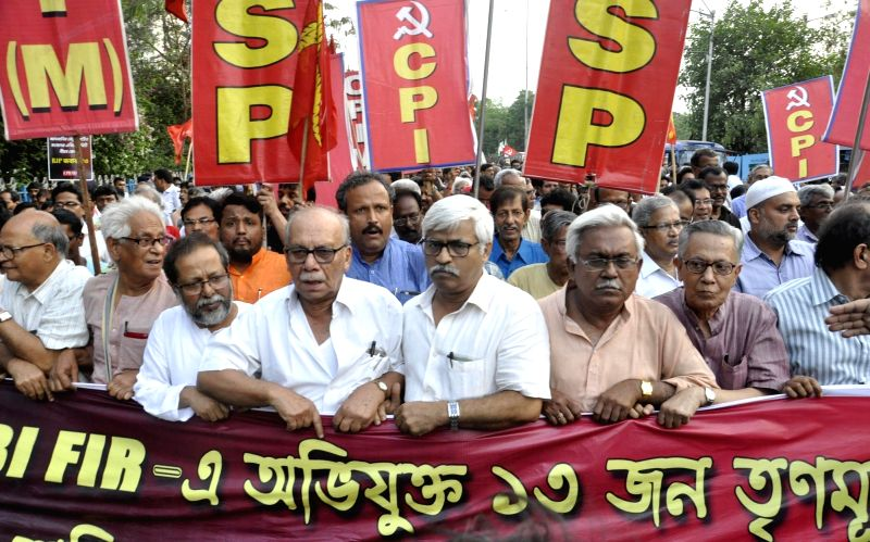 Left Front leaders lead a demonstration to press for the arrest of Trinamool Congress leaders whose names have surfaced in Narada sting in Kolkata on April 18, 2017.