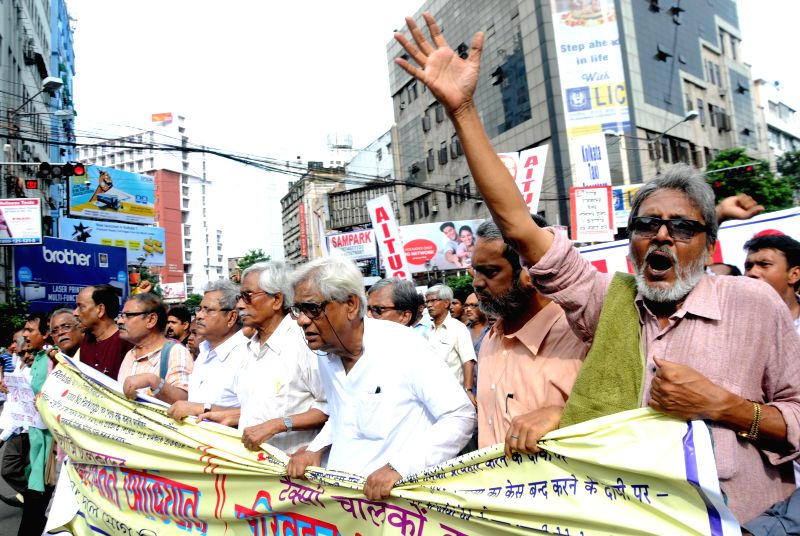 Left Trade Union leaders take part in a demonstration against police atrocities in Kolkata on Aug 28, 2014.