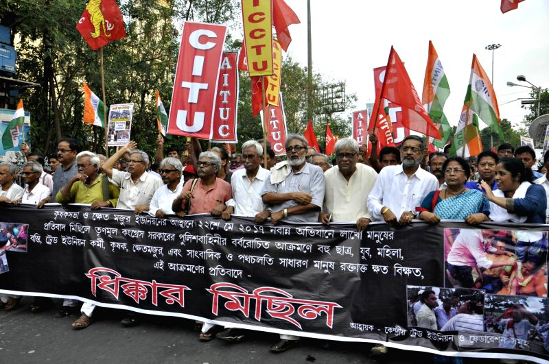 Leftist Trade Union members stage a demonstration against  22 May police action in Kolkata on May 2, 2017.