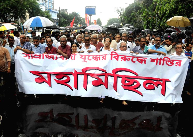 Leftists participate in a rally organised to observe Anti-Imperialist Day in Kolkata on Sept 1, 2014.