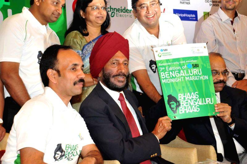 Legendary athlete Padmashri Milkha Singh and the brand ambassador for the SBI Bengaluru Midnight Marathon 2013 unveils the theme of `Bhaag Bengaluru Bhaag` at a press conference where the seventh ... - Padmashri Milkha Singh