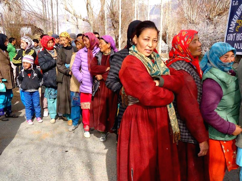 Women queue-up outside a  polling booth in Leh to cast their votes during the first phase of Jammu and Kashmir polls in Ladakh district of the state on Nov 25, 2014.