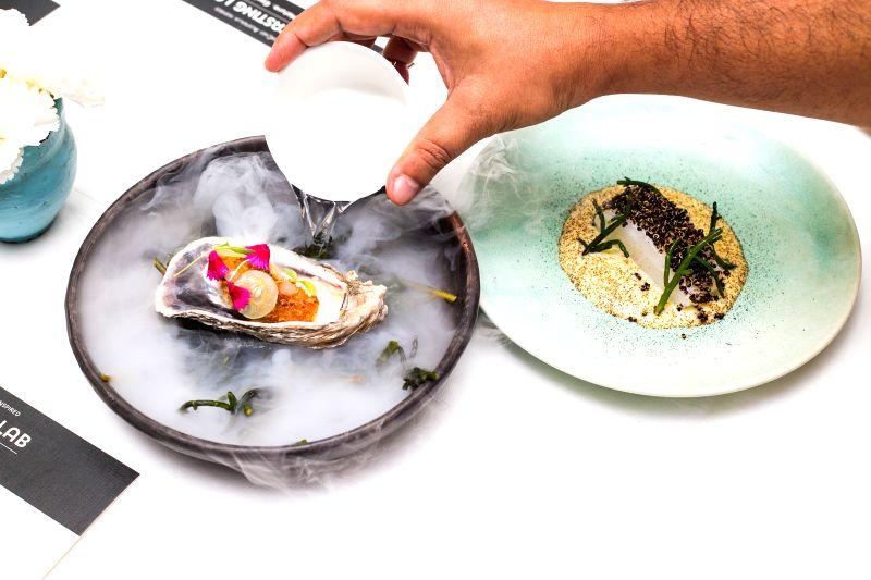 Lemon sole, oyster, black garlic, sea arom