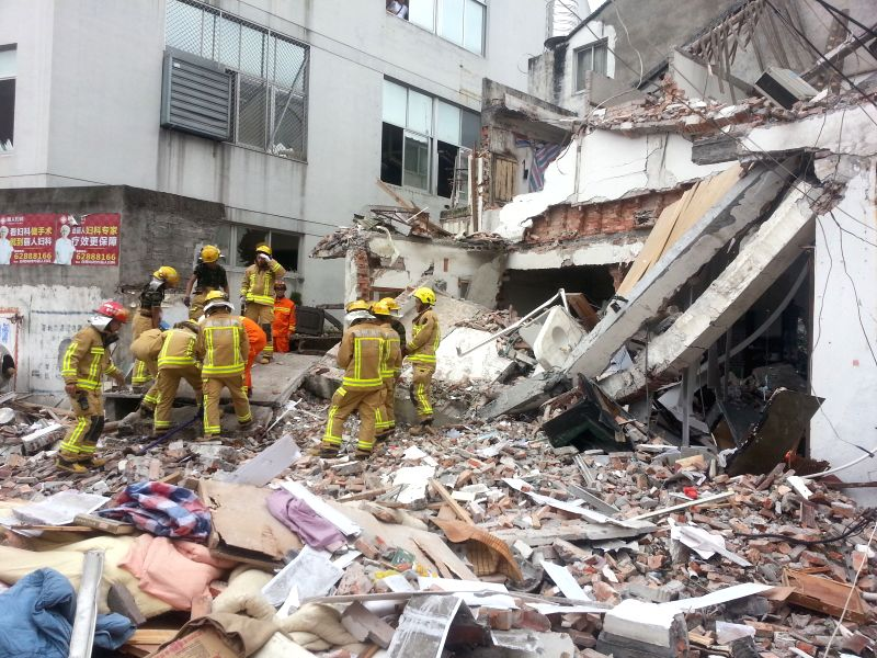 Firefighters work at the site of gas explosion in Pandong Village of Leqing City in Wenzhou, east China's Zhejiang Province, Aug. 11, 2014. A gas explosion toppled a