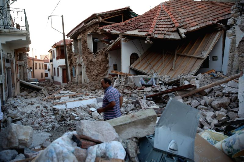 LESVOS ISLAND (GREECE), June 12, 2017 A man walks on the rubble of destroyed houses after an earthquake in Lesvos Island, Greece, on June 12, 2017. At least one person was killed and ...