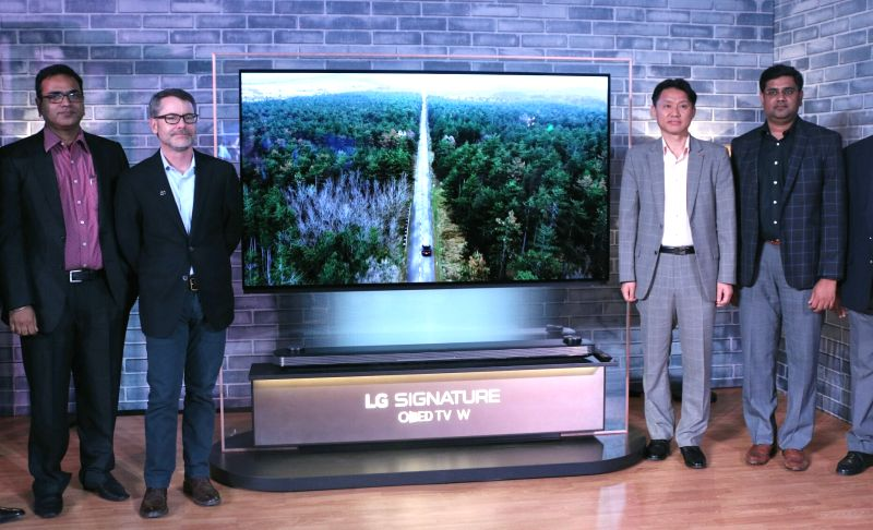LG Director Younchul Park and Marketing Head Abhiral Bhansali at the launch of LG OLED 4K TV in New Delhi, on June 6, 2017.