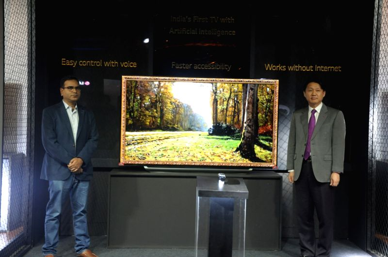 LG Electronics India  Director-Home Entertainment, Younchul Park along with other officials during the launch of LG OLED Artificial Intelligence (AI) ThinQ Television, in New Delhi on July ...