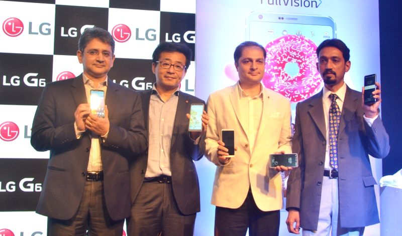 LG Electronics Marketing Head Amit Gujral with Managing Director Kim-Ki-Wan at the launch of LG-G6 smartphones in New Delhi on April 24, 2017.