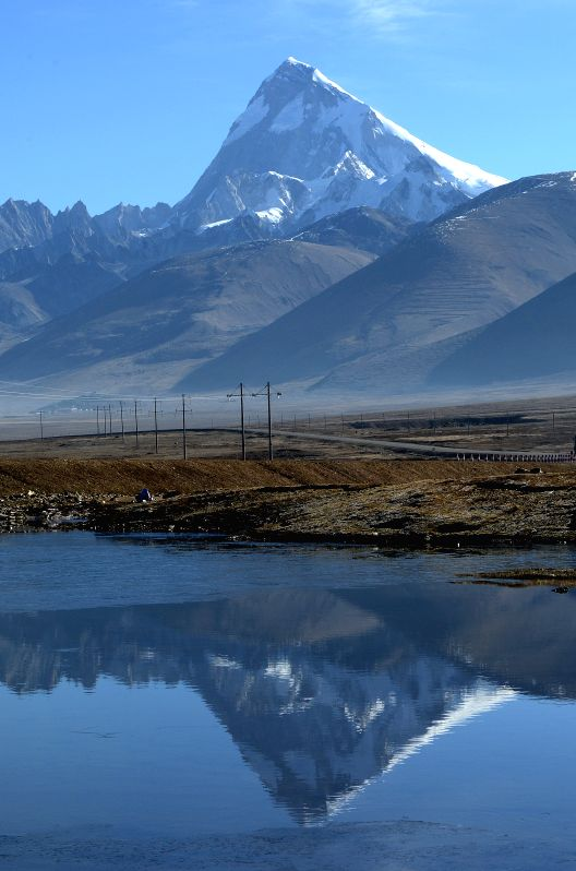 Photo taken on April 22, 2014 shows the Mount Jomolhari, a mountain in the Himalayas, in Yadong county, southwest China's Tibet Autonomous Region.  ...