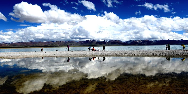 "Tourists visit the Nam Co (""heavenly lake"" in Tibetan) in Damxung County, southwest China's Tibet Autonomous Region, June 23, 2014. The Nam Co has entered .."