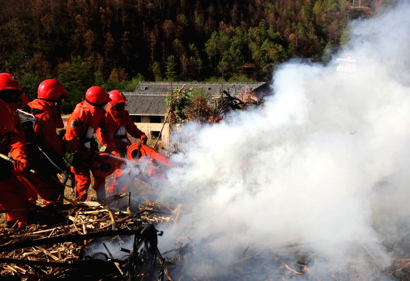 Firefighters take part in a forest fire drill in Liangshan, southwest China's Sichuan Province, April 9, 2015.