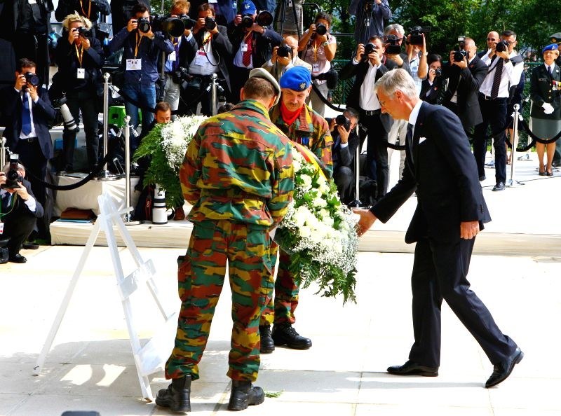 Belgian King Philippe (R) lays a wreath during a ceremony to commemorate the 100th anniversary of the outbreak of the First World War in Liege, Belgium, Aug. 4, 2014. .