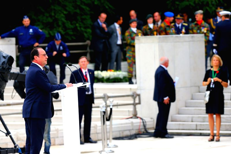 French President Francois Hollande (L) speaks during a ceremony to commemorate the 100th anniversary of the outbreak of the First World War in Liege, Belgium, Aug. 4,