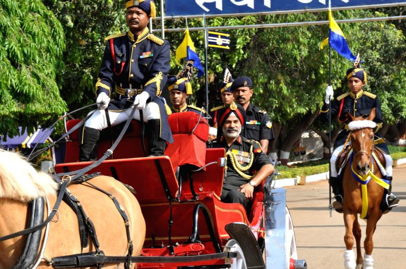 Lieutenant General Balbir Singh Sandhu arrives in a buggy to review the passing out parade in Bengaluru on April 24, 2017.