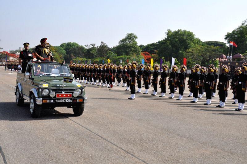 Lieutenant General Balbir Singh Sandhu reviews the passing out parade in Bengaluru on April 24, 2017.
