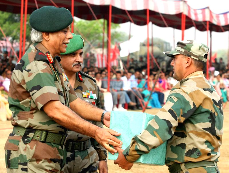 Lieutenant General R P Sahi, Commandant, OTA felicitates on of the participants during the Combined display - a prelude to the Passing Out Parade - organised at Officers Training Academy (OTA), in ...