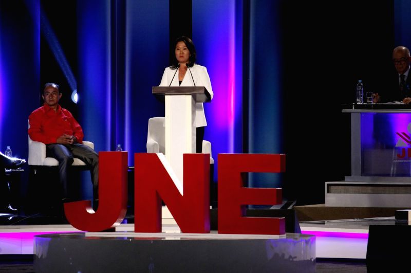 LIMA, April 4, 2016 - Presidential candidate of the Popular Force party Keiko Fujimori (C) takes part in the presidential debate in Lima, capital of Peru, on April 3, 2016. The debate of the ten ...