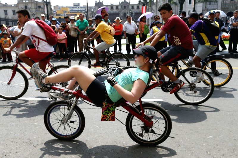 Residents take part in a bike ride to commemorate the 480th anniversary of the founding of Lima, in Lima, Peru, on Jan. 25, 2015.