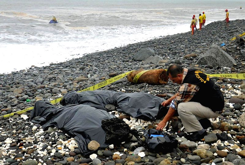 LIMA, June 3, 2017 - Members of the police work at the site where the bodies of soldiers who died during a swimming training routine are placed at Marbella beach in the district of Magdalena del Mar, ...